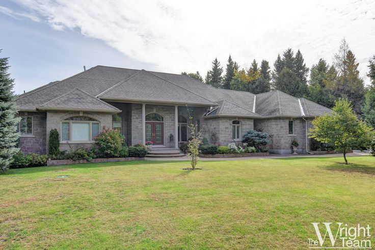 The private, treed estate lot with exceptional landscaping creates a one of a kind setting for this spectacular custom bungalow that echoes a Mediterranean architecture. Large front and rear porches extend the seasonal living areas. Magnificent, bright, beautiful interior has top quality, carefully selected finishes.