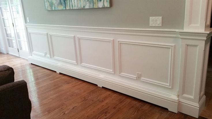 Even the nicest homes with wonderful trim details can sometimes have these monstrosities……..Metal covers for the baseboard heat.