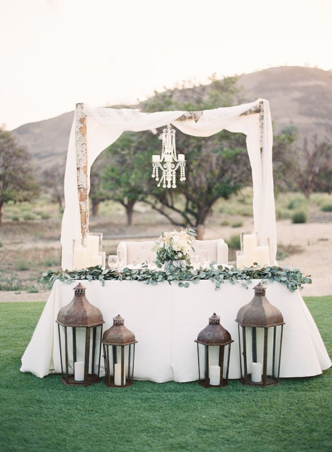 Elegant sweetheart table for the bride + groom: http://www.stylemepretty.com/california-weddings/san-juan-capistrano/2016/01/26/elegant-organic-san-juan-capistrano-wedding/ | Photography: Sposto Photography - http://spostophotography.com/