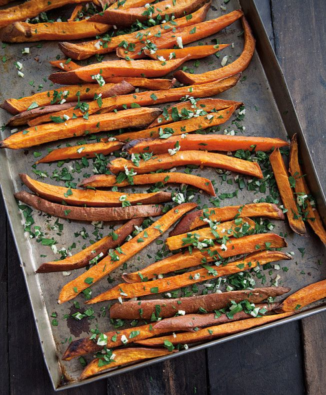 lb. (1 kg.) orange-fleshed sweet potatoes 2 Tbs. olive oil 1/4 tsp. coarse sea salt 3 Tbs. freshly grated Parmesan cheese 2 Tbs. chopped fresh flat-leaf parsley 1 clove garlic, minced