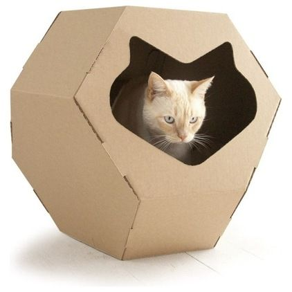 This cat hideout combines geometry with a cat's-head silhouette. It's made of superior-grade durable recycled cardboard and outfitted with t...