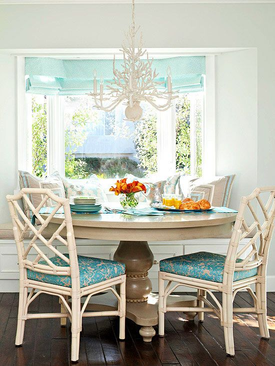 Banquette seating in a bay window.love the chairs and chandelier. Via bhg.com
