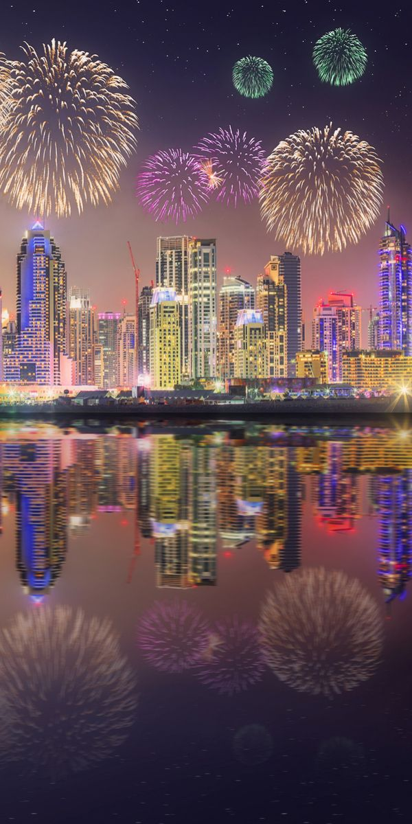 Dubai, UAE - I like this photo because it shows a little bit of the night life you would get to experience in Dubai. It also has a really nice reflection because it is by the water. The building and the fireworks and colors all work together to make the image look really nice.