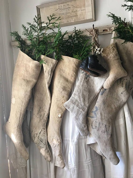 """Antique grainsack stockings!! Each is One of a Kind! This one has original patches scatted about, marvellous texture and colour. The backside is natural linen. Perfect primitive style for Christmas...Measures 26"""" to the toe and 8"""" across the top."""
