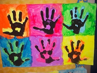 I've done this project before, but only with the colored background and black hand prints...I like this version better! Background one color, a colored hand print and then a black hand print on top of the colored one!
