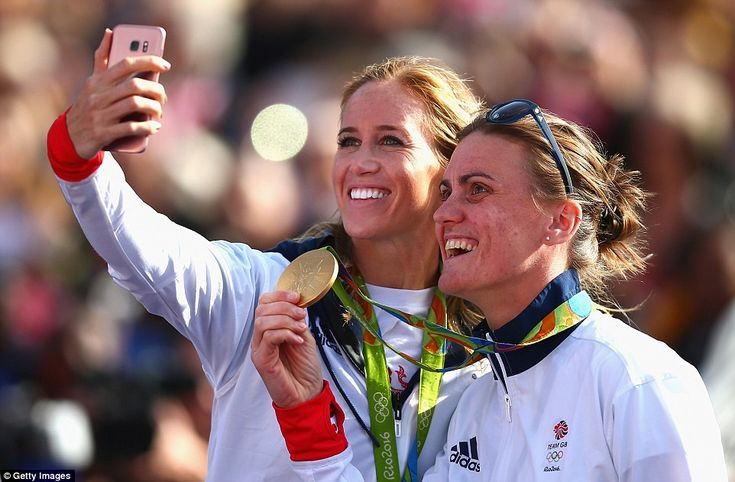 Golden rowing girls Helen Glover (left) and Heather Stanning (right) smile for a selfie at today's Trafalgar Square celebrations
