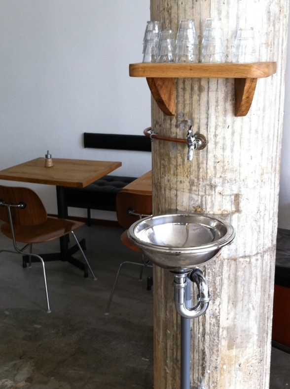 free water stand | at hopper coffee | rotterdam, netherlands - Creative use of a column and integration of water stand. Never saw this in Italy in all the coffee bars we visited.
