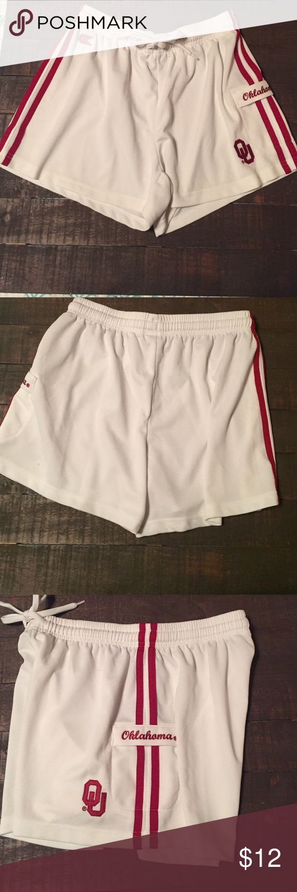 OU University of Oklahoma jersey shorts OU University of Oklahoma jersey shorts. White with red stripes and wording. Small spot pictured in last photo. I never noticed it until I folded them for the pictures. Colosseum Athletics Shorts