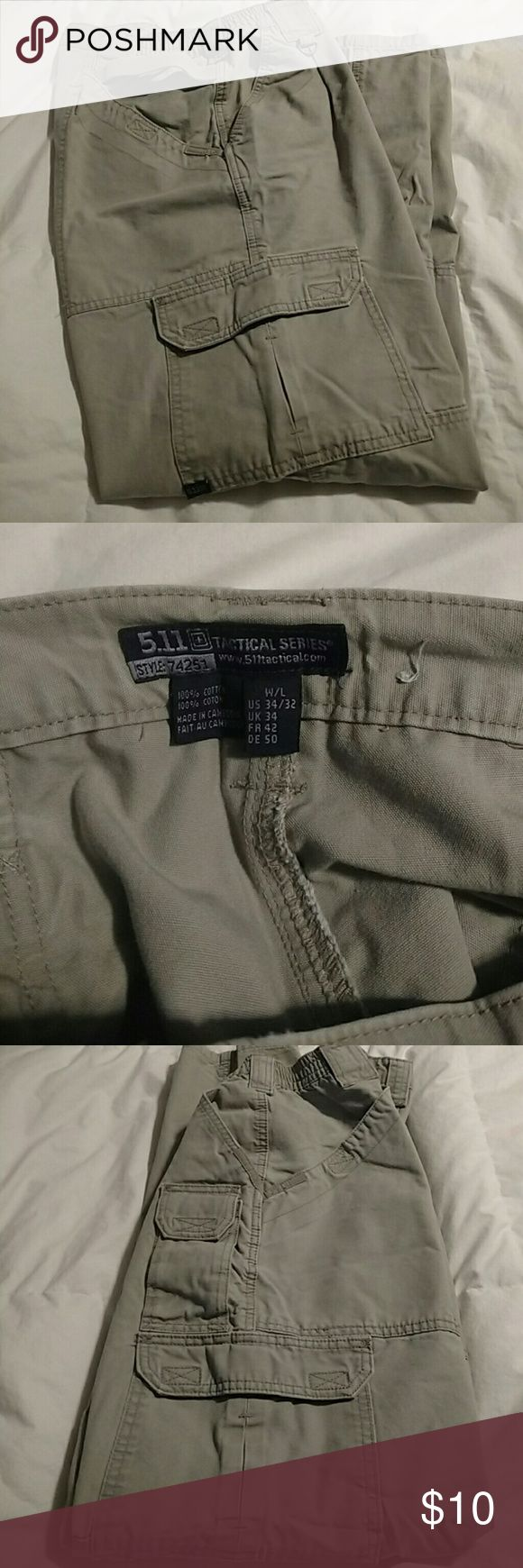 Men's 511 Tactical series Khaki pants These khakis are in good used condition.  Slightly faded, but all Velcro still has good sticking power and the zipper works.  Size 34/32. 5.11 Tactical Pants Cargo