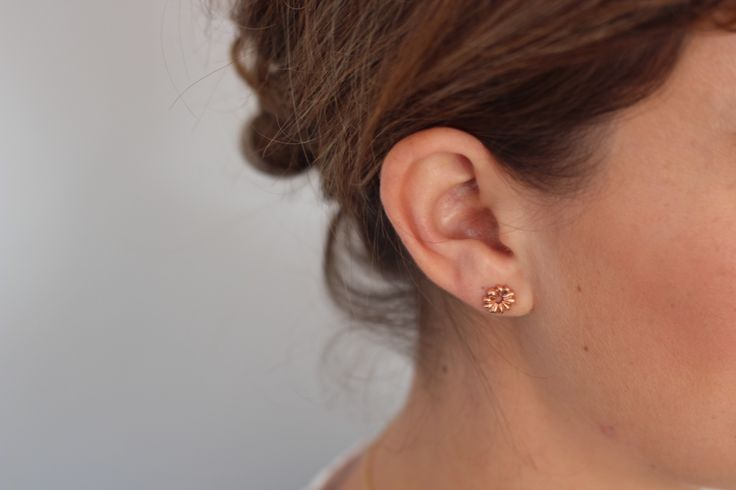 $400 gold studs designed for a lifetime. 14k rose gold Aster Ray studs