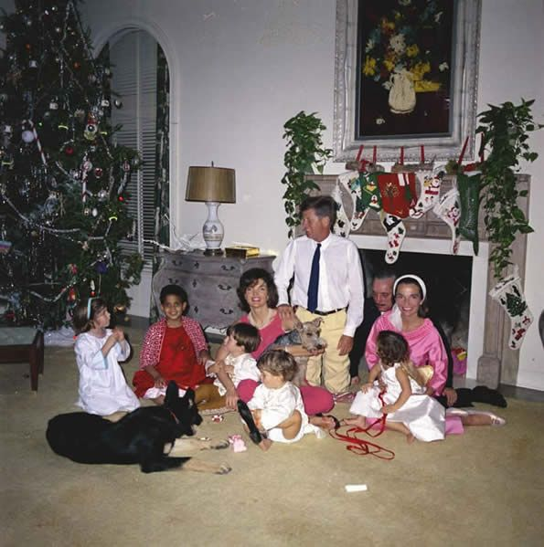 President and Mrs. Kennedy and Prince and Princess Radziwill celebrate Christmas together with their families ~ Dec 1962 How adorable is the Prez rolling about on the floor with John John and...