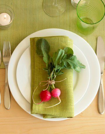 What a simple and lovely idea for a place setting. A small bunch of radishes are tied together with twine and placed upon a cloth napkin, creating a very organic (literally) yet modern table tableau. A great idea for your next dinner party.