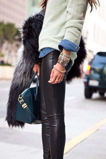 Such a cool look—and so easy to recreate. All it takes is a pair of leather (or faux) leggings, a denim shirt and your favorite sweater. From there, pile on the bracelets, grab your favorite structured bag and top it off with a cool fur coat. Perfect daytime outfit!