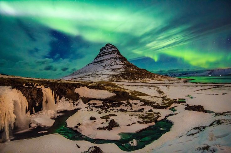 Mount Kirkjufell under the night sky Aurora Borealis