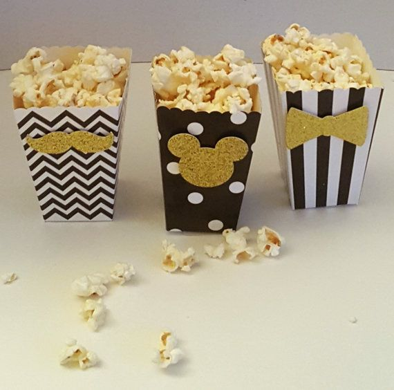 Description  Take your movie night to the next level with these stylish popcorn containers. These chic little containers are made from high quality 300gms glitter stock card paper and come in 4 different colors and 3 different designs. If you are the creative type and have a different style or design in mind send me a message and we can try to make your creativity come to life. These adorable little containers are perfect for a movie themed wedding; your guests can splurge on popcorn and…