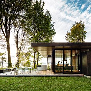 Are you in or out? You can barely tell the difference in this modern cabin full of natural materials and expanses of glass