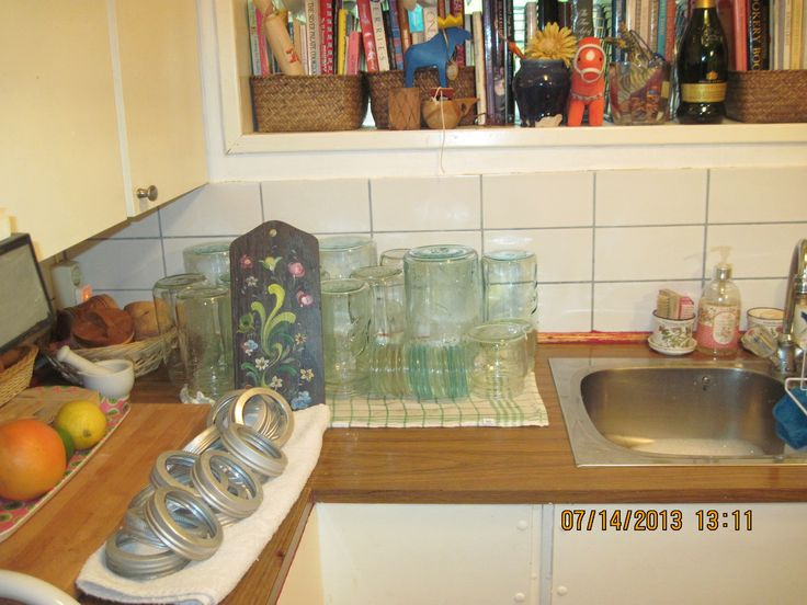 vintage kitchen, some of the cookbooks, lots of vintage glass jars with glass lids, and an old rosemaling cheeseboard