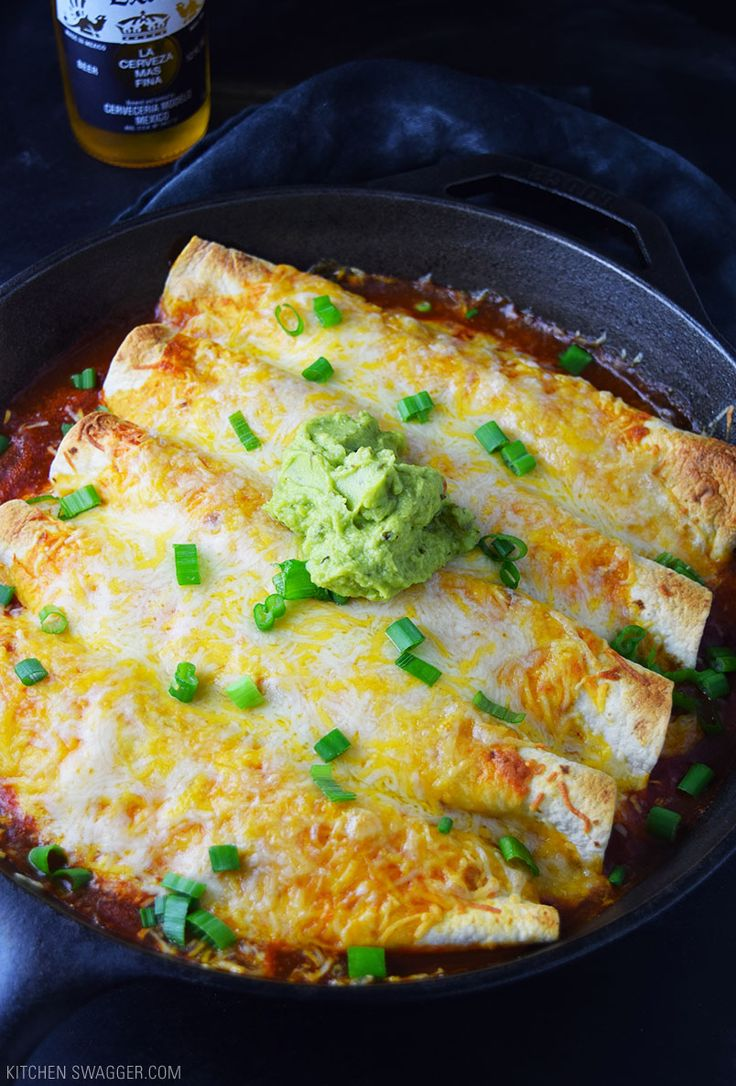 Chicken enchiladas made in a single cast iron skillet.