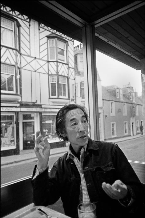 Photographer Hiroshi Hamaya in a cafe, Scotland, 1973 by Ian Berry