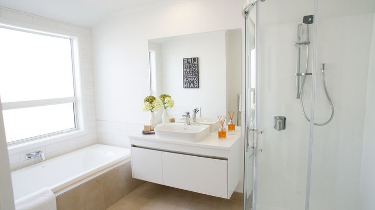 Tile Warehouse Subway tiles, brick gloss white & décor, with stainless steel trip (bath cradle and wall surround)
