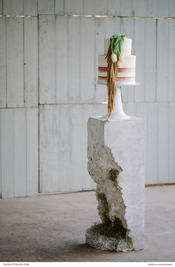 Naked two tiered wedding cake with white flowers   Photography: Tasha Seccombe Photography   Styling and coordination: Agape Wedding & Event Design  