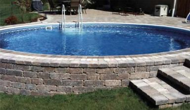 semi inground swimming pool- maybe we really can have a pool in our sloped backyard!