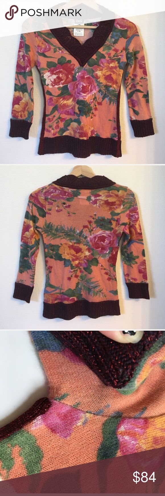 """{ Dolce & Gabbana } sweater shirt D & G sweater shirt 34% nylon 34% angora 21% wool 7% acetate 4% other. 7/8 sleeves, v neck, knit trims, back has leather logo tag sewn on I had to fix by restitching on since one side was loose. Previously worn and has normal wear to it and a few spots that the knit is a little """"pulled"""" looks almost like a hole (see picture example please). Measures approx laying flat pit to pit 15""""mid shoulder down 21"""". Has light stretch only. Hologram pictured. Size is…"""