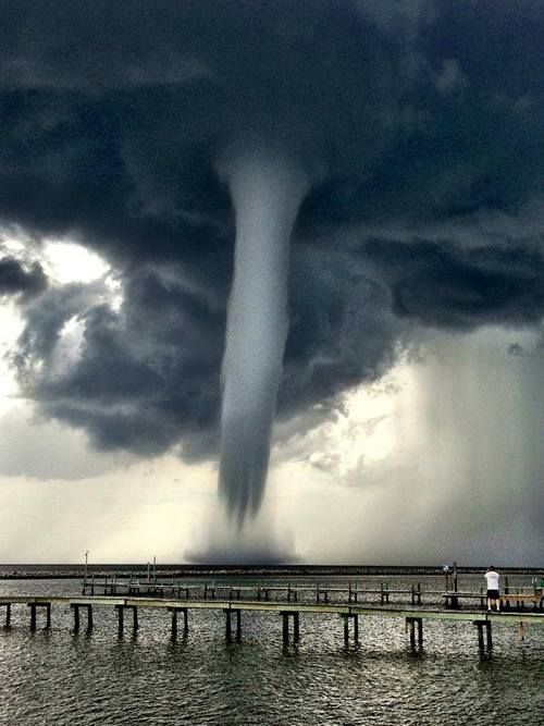 An amazing shot from June 19 in Grand Isle, La. Way too close though…. just a little too close for comfort!