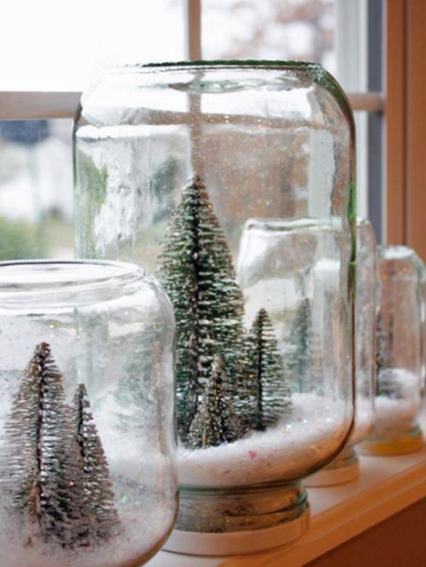 How To: Make a Waterless Snow Globe  - Hot glue small Christmas trees, houses, Santa sleds or reindeer to the jars' lids, pour fake snow in the jar screwing on the lid and flip over so all the ornaments have snow over them for an instant Christmas scene snow globe.