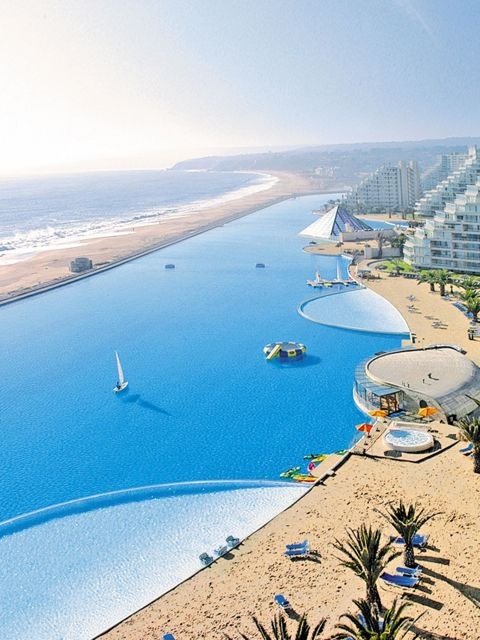 San Alfonso del Mar Resort Pool; Algarrobo, Chile  Cool Fact: Covering an area of 20 acres, the pool at the San Alfonso del Mar resort currently holds the record in the Guinness Book of World Records for being the world's largest pool. San Alfonso del Mar is a private resort west of Santiago. With so much space, the pool features several amentities including a climate controlled beach and an outdoor spa. Guests can even take out a kayak or take sailing lessons right in the pool. Apart from…