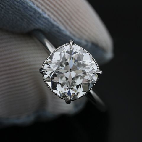 RINGS & THINGS - Beautiful cushion cut stone with clawfoot prongs and a thin band. I would pass on the milgrain detail, though.