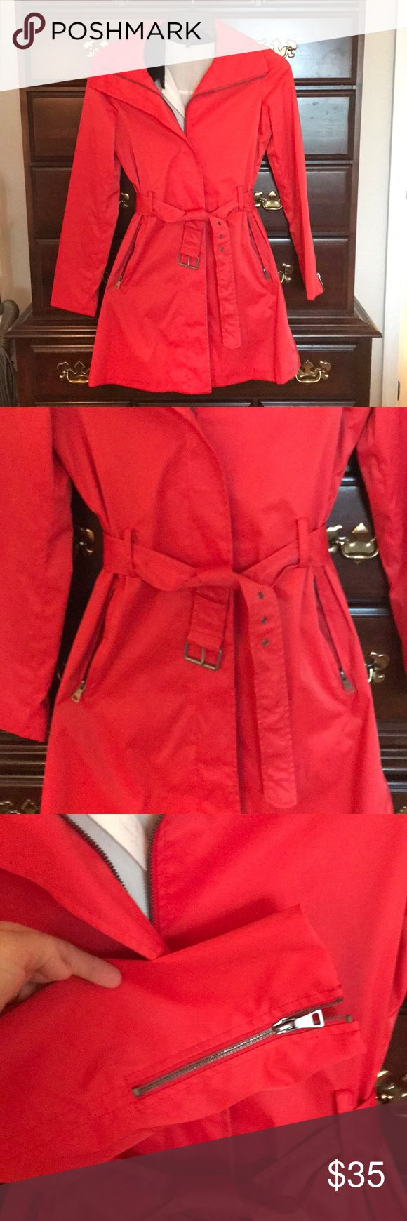 Mossimo rain resistant coat Red Mossimo water resistant coat. Both sleeves have a zipper at the wrist. There is a slit in tail of the coat. Zips up the front and has a belt. Excellent condition.   Shell- 52% cotton 45% nylon & 3% spandex Lining- 100% polyester  Machine washable Mossimo Supply Co Jackets & Coats