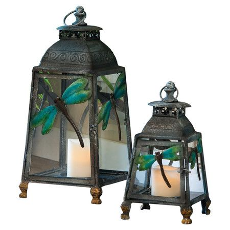 Set of 2 metal candle lanterns with glass panes and dragonfly motifs.  Product: Small and large candle lanternConstr...
