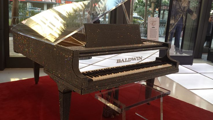 The Baldwin piano Liberace played on display in Las Vegas along with some of his wild costumes.