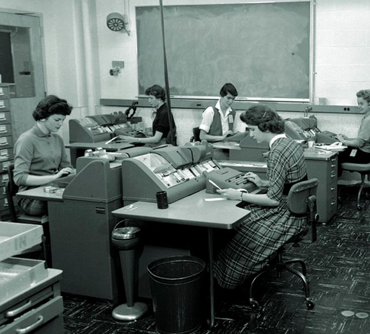 A Group Of 1940s Ladies Hard At Work On Silent Speed Mechanical  Calculators. Vintage OfficeBusiness ...