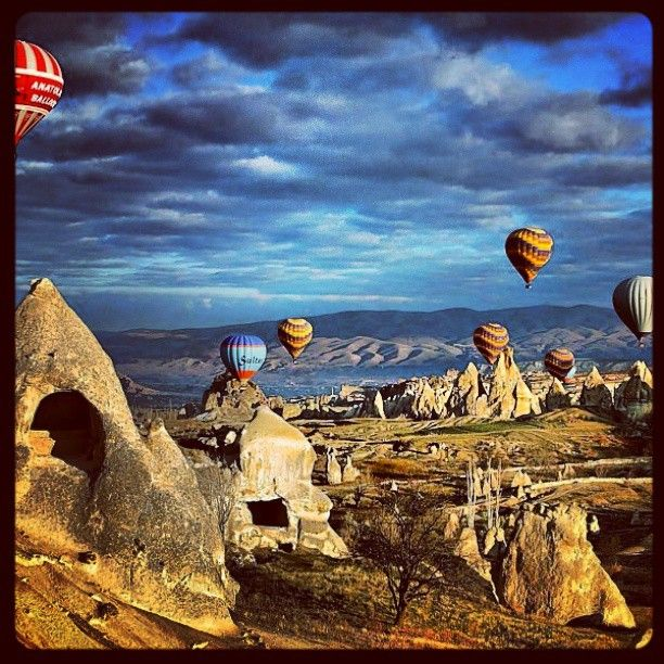 Take a hot air balloon high into the sky over the caves of Kapadokya.