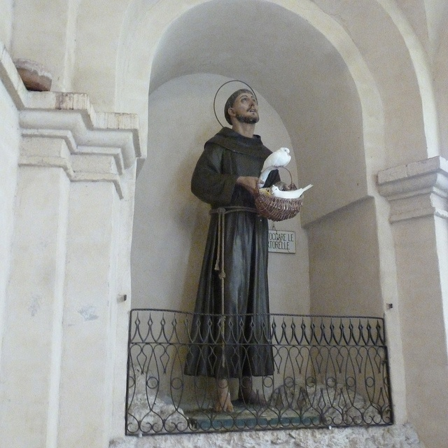 St Francis of Assisi, Italy When one dove flies away...another takes its place.  For as long as we stood and watched,  this statue was never without a dove perching in the basket.