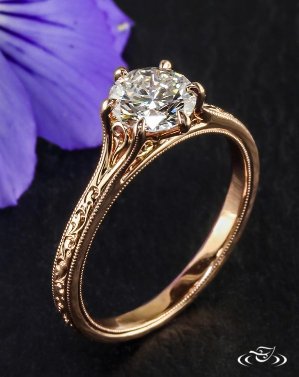 •Rose Gold Filigree Engagement Ring• Filigree curls sweep up the shoulders and in the under gallery of this timeless rose gold prong set engagement ring detailed with hand engraved scrolls. #GreenLakeJewelry #EngagementRing