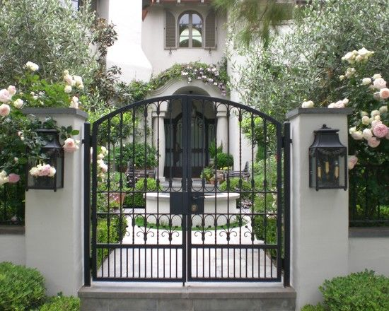Note how the elegant wrought iron gate provides a window into the courtyard.