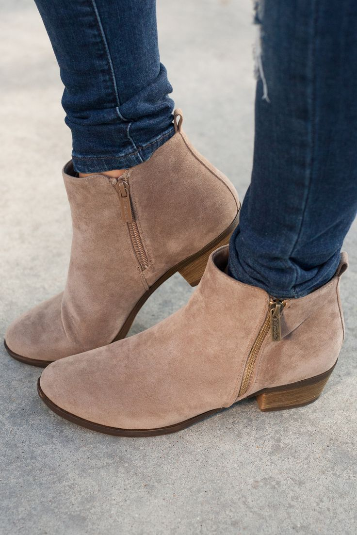 With a faux suede finish this bootie is nothing short of  stylish, featuring a short faux stacked heel, and zippers on either side for easily getting them on an