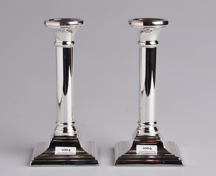Silver candle sticks with square foot, 17 cm high, you can see them at http://notarishuis-arnhem.orangebite.com/object/570