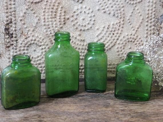 Hey, I found this really awesome Etsy listing at https://www.etsy.com/listing/219838401/vintage-green-glass-bottle-collection