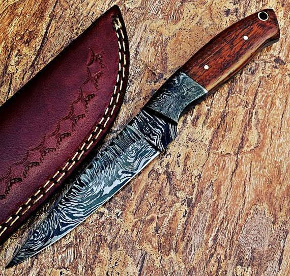 beautiful hand made Damascus knife handle made with wood fixed with damascus bolster comes with leather sheath total length 8 blade length 4 handle length 4 blade material Damascus steel 15N20 & 1095 hand forged blade harndness is 55- 58 hrs on Rockwell scale total layers 512