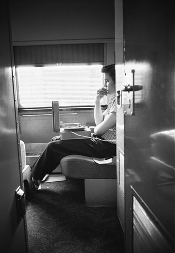 Check out the turntable.  Elvis Presley reviewing recordings from a New York session on July 3rd, 1956.