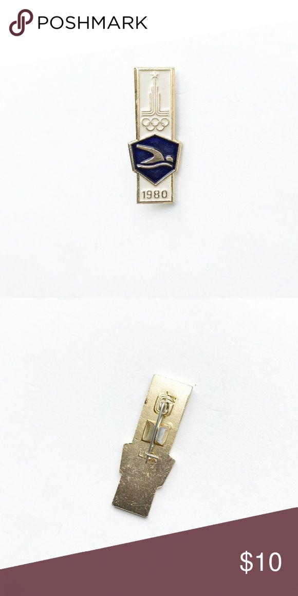 """'80 Olympics Swimming Enamel Pin 1980 Olympic Swimming Enamel Pin  • true vintage • 1  1/4"""" x 1/2"""" • colors: gold, white, blue • tags: moscow, Russia, sports, athletics, team, game, champions, winning, history, rings, building, 80s, eighties, swimming, sprinting, pole vaulting, volleyball, summer, winter, gold, silver, bronze medal, USA, America, hat, jacket, vest, lapel • all of the pins I sell are vintage and may contain minor nicks, imperfections, or oxidation Vintage Accessories"""