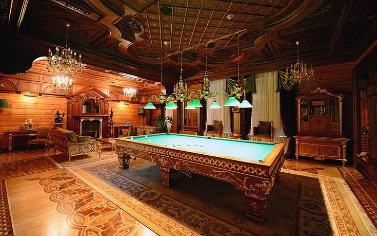 More pictures from inside Viktor Yanukovych's Mezhyhirya palace have emerged showing the oppulent lifestyle enjoyed by Ukraine's fugitive leader. Here, a highly-decorated pool table in the games roomPicture: JEFFREY J. MITCHELL/GETTY IMAGES