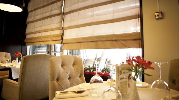 http://taizh.com/wp-content/uploads/2014/11/Simple-curtain-restaurant-in-glass-window-with-lighting-hanging-ceiling-and-white-round-dining-table-also-fabric-dining-chair.jpg