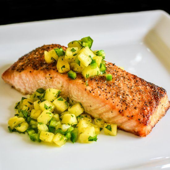 Perfectly cooked salmon topped with a salsa made from pineapple, jalapeño, scallion, lime juice, and cilantro!