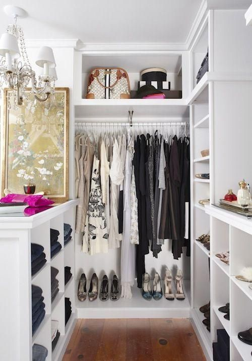 chic neat white themed walkin closet design inspiration with small floorspace and sparkling white chandelier beautiful walkin closet designs for