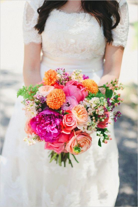 hot pink and orange bouquet #bride #bouquet #weddingchicks http://www.weddingchicks.com/2014/03/25/hot-pink-and-purple-two-day-wedding/